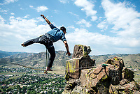 Working with experts at Rocky Mountain Slackline, The Adventurist columnist, Clint Carter  attempts a highline walk at North Tale Mountain in Golden, Colorado, Tuesday, August 29, 2017. Carter take on a vertigo-inducing highline&nbsp;that stretches across a traverse after only 4 days of training.<br /> <br /> Photo by Matt Nager
