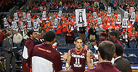Virginia fans hold up signs taunting the Virginia Tech  bench with national championship trophies won by Virginia during the game Saturday in Charlottesville, VA. Virginia won 65-45. Photo/The Daily Progress/Andrew Shurtleff