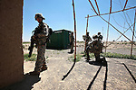 Sgt. Christopher Cardova, 29, of Houston, Texas, and other soldiers with Company A, 2nd Battalion, 2nd Infantry Regiment, stop during a patrol in the village of Mir Hotak in Kandahar province, Afghanistan.  April 15, 2009. DREW BROWN/STARS AND STRIPES
