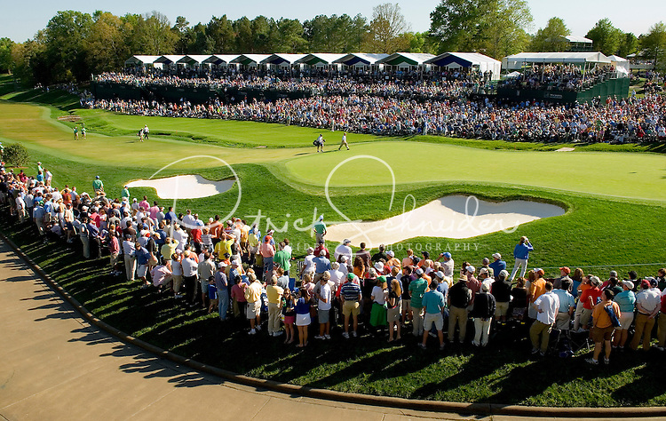 Wide angle view of the crowds gathered around the 18th green during the 2007 Wachovia Championships at Quail Hollow Country Club in Charlotte, NC.