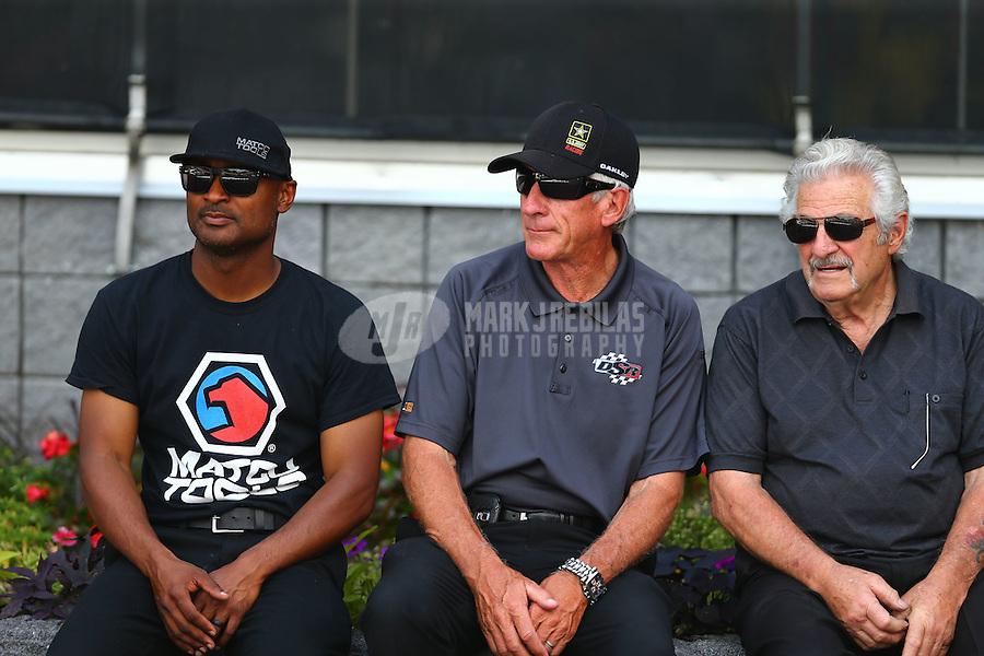 Jun 21, 2015; Bristol, TN, USA; NHRA top fuel driver Chris Karamesines (right) sitting with Mike Lewis (center) and top fuel driver Antron Brown during the Thunder Valley Nationals at Bristol Dragway. Mandatory Credit: Mark J. Rebilas-