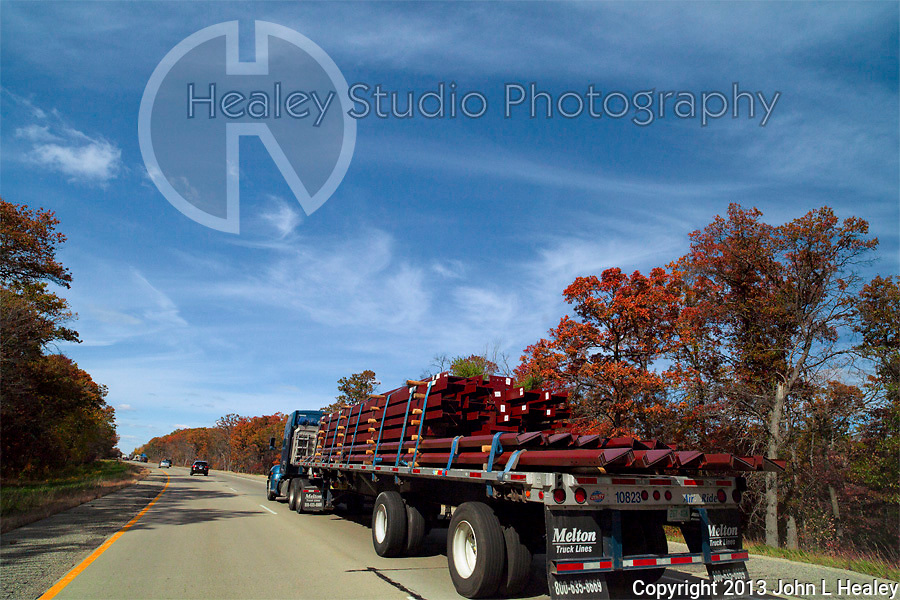 Americana Series: Road Trip<br /> <br /> Steel being transported through New England foliage