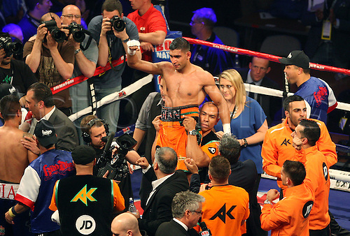 27.04.2013 Sheffield, England. Victorious Amir Khan is held aloft - Amir 'King' Khan against Julio 'the Kidd' Diaz from the Motorpoint Arena. Khan won on a unanimous points decison after a tough fight that saw his put down on the canvas in the 4th round.