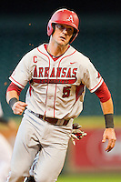 Matt Reynolds #5 of the Arkansas Razorbacks hustles towards third base against the Houston Cougars at Minute Maid Park on March 3, 2012 in Houston, Texas.  The Cougars defeated the Razorbacks 4-1.  Brian Westerholt / Four Seam Images