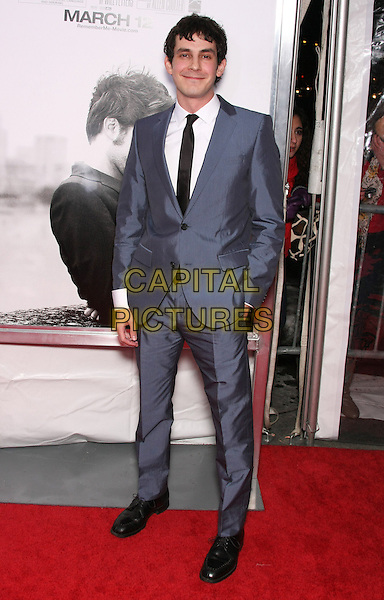 "TATE ELLINGTON.The World Premiere of ""Remember Me"" held at the Paris Theater, New York, NY, USA..March 1st, 2010.full length grey gray blue suit hand in pocket shiny .CAP/LNC/TOM.©LNC/Capital Pictures."