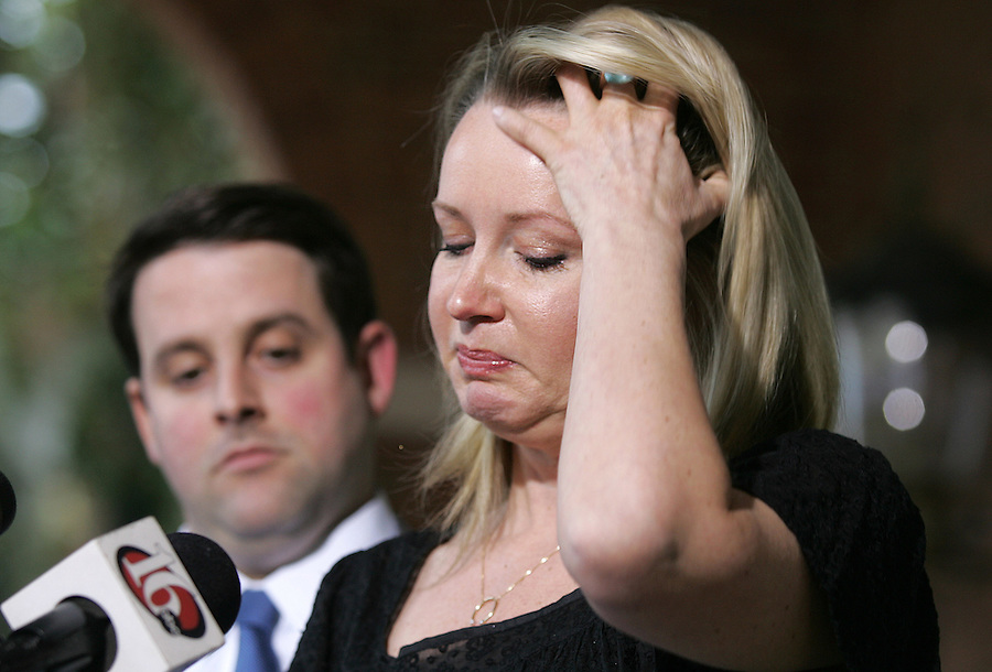 Liz Securro, right, with the support of her husband Michael Seccurro, left, talks with media outside the Charlottesville Circuit Court after William Beebe was sentenced to 18 months in prison and 500 hours of community service Thursday, March 15, 2006 in Charlottesville, VA. Seccurro accused Beebe of assaulting her during a party at U.Va.'s Phi Kappa Psi fraternity house 22 years ago. Photo/Andrew Shurtleff