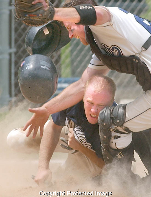 Mike Brabender of Middleton Home Talent collides with a Waunakee catcher as he slides into home plate.