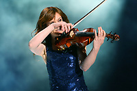 French-Canadian artist Mara Tremblay plays the violon during the St-Jean-Baptist show on the Plains of Abraham in Quebec city June 23, 2009.