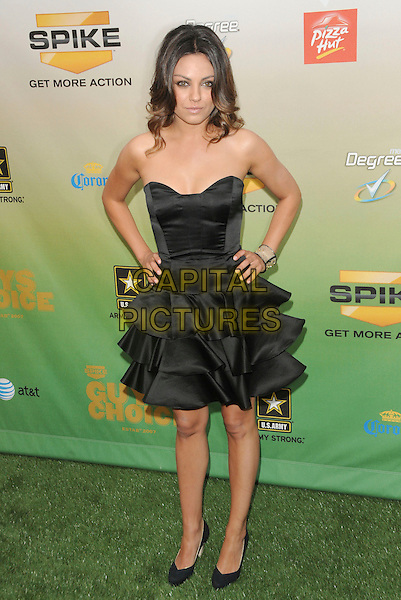 MILA KUNIS .at The 2009 Spike TV Guy's Choice Awards held at Sony Picture Studios in Culver City, California, May 30th 2009.                                                                     .full length strapless black bustier dress tiered ruffles hands on hips shoes silk satin .CAP/DVS.©Debbie VanStory/RockinExposures/Capital Pictures
