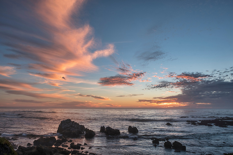 Blazing clouds of sunset hover over Otter Cove at West Ranch Preserve, Cambria.