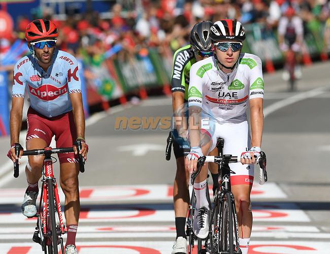 White Jersey Tadej Pogacar (SLO) UAE Team Emirates crosses the finish line after being involved in a huge crash with 1km to go at the end of Stage 14 of La Vuelta 2019  running 188km from San Vicente de la Barquera to Oviedo, Spain. 7th September 2019.<br /> Picture: Karlis | Cyclefile<br /> <br /> All photos usage must carry mandatory copyright credit (© Cyclefile | Karlis)