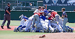 Reno Huskies dog-pile after winning the NIAA Division I Northern Region Baseball Championship between the Galena Grizzlies and the Reno Huskies played on Saturday, May 14, 2016 at Peccole Park in Reno, Nevada.