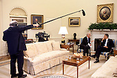 """Washington, DC - May 29, 2009 -- United States President Barack Obama meets with Vice President Joe Biden in the Oval Office while NBC sound and video crews record footage for the prime-time special """"Inside the Obama White House,"""" May 29, 2009..Mandatory Credit: Pete Souza - White House via CNP"""