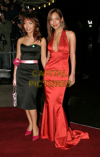 MYLEENE KLASS & SISTER.Cirque Du Soleil charity performance at the Royal Albert Hall and aftershow dinner at the V&A Museum.5 February 2004.full length, full-length, long halterneck red satin dress, cleavage, plunging neckline, pin, badge.www.capitalpictures.com.sales@capitalpictures.com.© Capital Pictures.