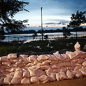 DOBRZYKOW, POLAND, MAY 24, 2010:.Sand bags wall at dusk..The latest chapter of disastrous floods in Poland has been opened yesterday, May 23, 2010, after Vistula river broke its banks and flooded over 25 villages causing evacualtion of most inhabitants..Photo by Piotr Malecki / Napo Images..DOBRZYKOW, POLSKA, 24/05/2010:.Sciana z workow z piaskiem wczesnym rankiem. Najnowszy akt straszliwych tegorocznych powodzi zostal rozpoczety wczoraj gdy Wisla przerwala waly na wysokosci wsi Swiniary kolo Plocka..Fot: Piotr Malecki / Napo Images ..