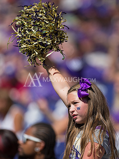 A young fan cheers on the Huskies.