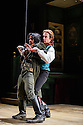 London, UK. 22.05.2015. THE BEAUX' STRATAGEM, by George Farquhar, directed by Simon Godwin, opens in the Olivier, at the National Theatre. Lighting design by Jon Clark, set and costume design by Lizzie Clachan, movement by Jonathan Goddard. Picture shows: Esh Alladi (Bagshot) and Geoffrey Streatfeild (Archer). Photograph © Jane Hobson.