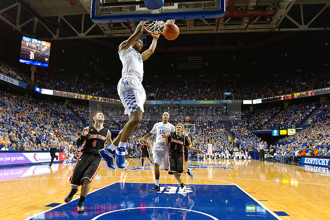 Aaron Harrison of the Kentucky Wildcats dunks during the first half of the game against the University of Georgetown Tigers at Rupp Arena on Sunday, November 9, 2014 in Lexington, Ky. Kentucky defeated Georgetown 121-52. Photo by Michael Reaves | Staff