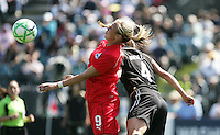 Allie Long (9) and Rachel Buehler (4) battle for the header.  Washington Freedom defeated FC Gold Pride 4-3 at Buck Shaw Stadium in Santa Clara, California on April 26, 2009.