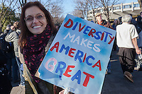 Sarajean Rossitto one of the organisers of a protest march and rally organised by the Alliance for an Inclusive America group against the perceived anti-Muslim and anti-foreigner immigration policies of President Donald Trump, Shibuya, Tokyo, Japan. Sunday February 12th 2017. The Alliance of an Inclusive America is a multi-faith non-partisan group. About 250 Americans, other ex-pats and japanese people took part in the march to show people around the world they reject the Executive Order President Trump enacted at the end of January, indefinitely suspending the resettlement of Syrian refugees and temporarily banning people from seven majority Muslim countries from entering the United States.