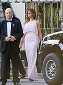 United States President Donald J. Trump and first lady Melania Trump depart the White House in Washington, DC to attend the wedding of US Secretary of the Treasury Steven Mnuchin and Louise Linton on Saturday, June 24, 2017.<br /> Credit: Ron Sachs / Pool via CNP United States President Donald J. Trump and first lady Melania Trump depart the White House in Washington, DC to attend the wedding of US Secretary of the Treasury Steven Mnuchin and Louise Linton on Saturday, June 24, 2017.  The first lady is wearing a Gilles Mendel silk chiffon gown with Manolo Blahnik pumps.<br />