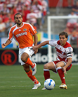 FC Dallas' Simo Valakari (17) passes the ball away from Houston Dynamo's Dwayne De Rosario (14) at Robertson Stadium in Houston, TX on Saturday May 6, 2006. The Houston Dynamo defeated FC Dallas 4-3.