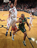 Dec. 20, 2010; Charlottesville, VA, USA; Norfolk State Spartans guard/forward Rob Hampton (1) handles the ball in front of Virginia Cavaliers guard Mustapha Farrakhan (2) during the game at the John Paul Jones Arena. Virginia won 50-49. Mandatory Credit: Andrew Shurtleff