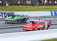 May 31, 2014; Englishtown, NJ, USA; NHRA pro mod driver Peter Farber (near lane) races alongside Eric Latino during qualifying for the Summernationals at Raceway Park. Mandatory Credit: Mark J. Rebilas-
