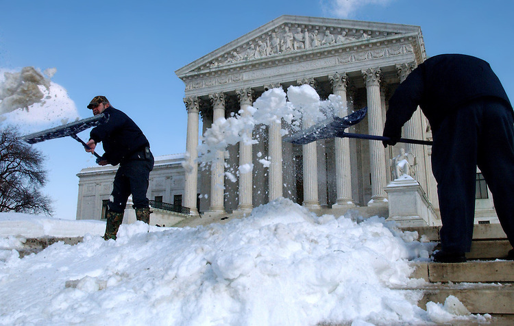snow1/021803 - Workers from the Office of Capitol Architect shovel show in fornt of the Supreme Court.