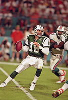 Vinnie Testeverde drops to pass as the Jets defeated the Dolphins 20-3 in Miami , FL on November 19, 2000. (Photo by Brian Cleary / www.bcpix.com)