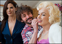 BNPS.co.uk (01202 558833)<br /> Pic: PhilYeomans/BNPS<br /> <br /> Final touches to Marilyn Monroe...<br /> <br /> Tinseltown comes to Dorset - Wax artist Michael Wade is surrounded with a surreal who's who of Hollywood stars in the unlikely surrounds of his Bridport studio.<br /> <br /> Michael has just completed a bumper order of silver screen idols for a new museum in America. His tiny studio is now home to John Wayne, Humphrey Bogart and Elvis as well as Sandra Bullock, Jennifer Aniston and even Marylin Monroe.<br /> <br /> Each work takes 3 months to create with a sculptor first creating the head before thousands of real hairs are individually inserted, next a hairdresser cuts and crimps, teeth made by a dentist are added along with bespoke eyes created by NHS technicians. <br /> <br /> After all this careful work Michael takes the waxwork to a dress maker to tailor a suitable outfit and then the stunning &pound;20,000 models are complete.