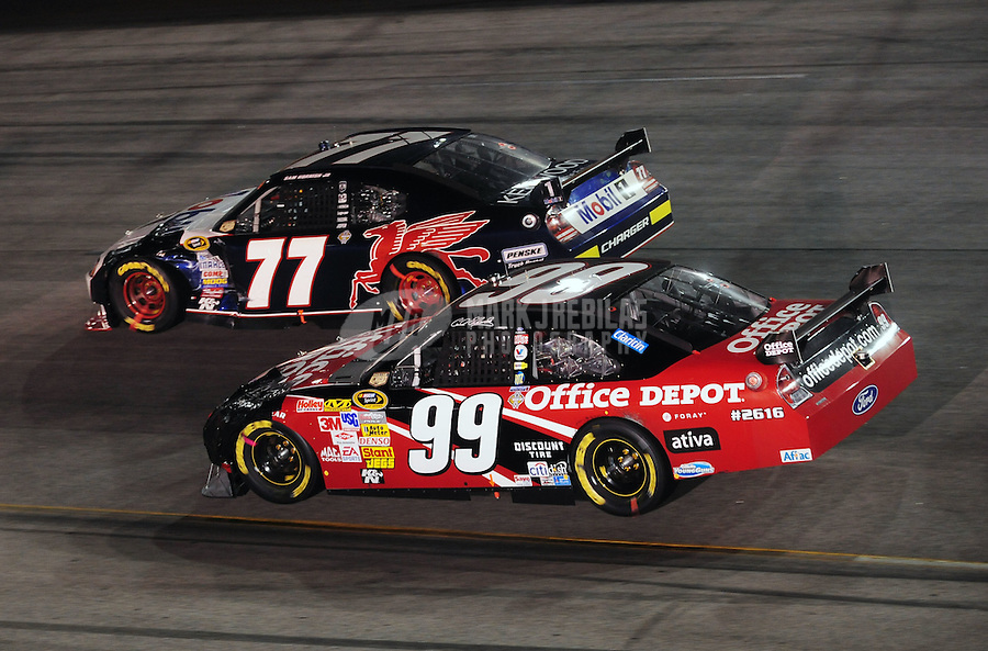 May 3, 2008; Richmond, VA, USA; NASCAR Sprint Cup Series driver Sam Hornish Jr (77) races alongside Carl Edwards (99) during the Dan Lowry 400 at the Richmond International Raceway. Mandatory Credit: Mark J. Rebilas-US PRESSWIRE