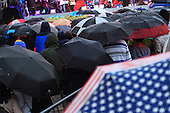 umbrellas cover the music fans at an outdoor jazz concert during the Montreal International Jazz Festival
