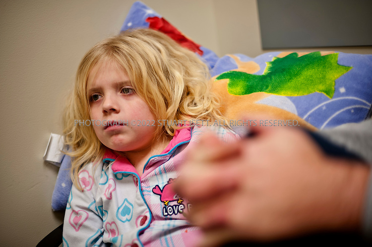 2/15/2012--Seattle, WA, USA..Bella Rose Johnson, 6, under heavy sedation at the Dental Surgery Center at the Centerfor Pediatric Dentistry in Seattle, WASH., a joint center run by the Seattle Children's Hospital and the University of Washington to provide dental services to children and infants. She came with her father Daniel Johnson (right)....©2012 Stuart Isett. All rights reserved.