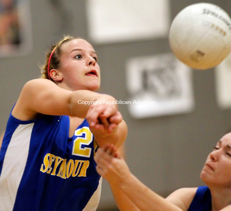 Beacon Falls, CT- 28, October 2010-102810CM10 Seymour's Christina Cretella (left) and teammate, Brittany Brassell jump to send the ball back to Woodland Thursday night in Beacon Falls. Christopher Massa Republican-American