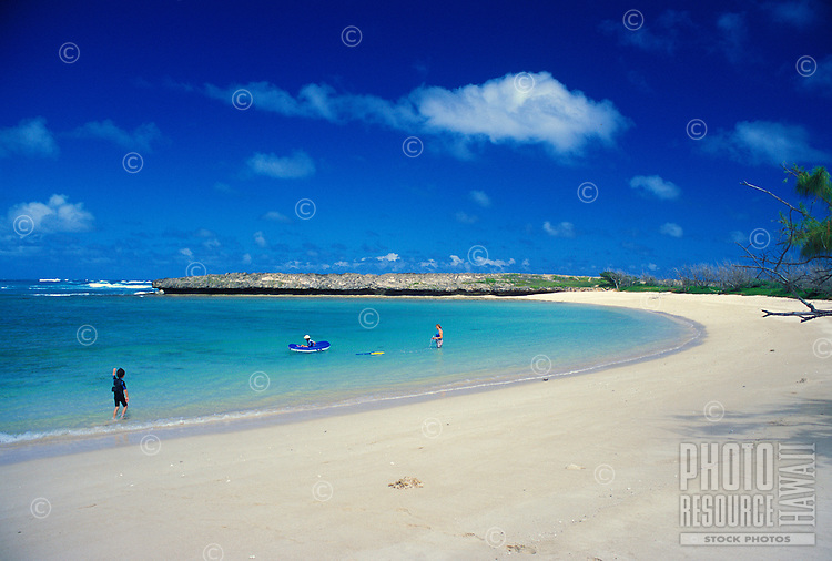 Secluded Mokuauia Beach and its clear ,placid bay and white sand are on Goat island located across from Malaekahana Bay State Recreation Area, near the town of Laie, windward Oahu.