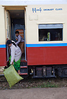 "Myanmar, Burma.  Passenger Leaving  Coach at Kalaw Train Station.  ""Ordinary Class."""