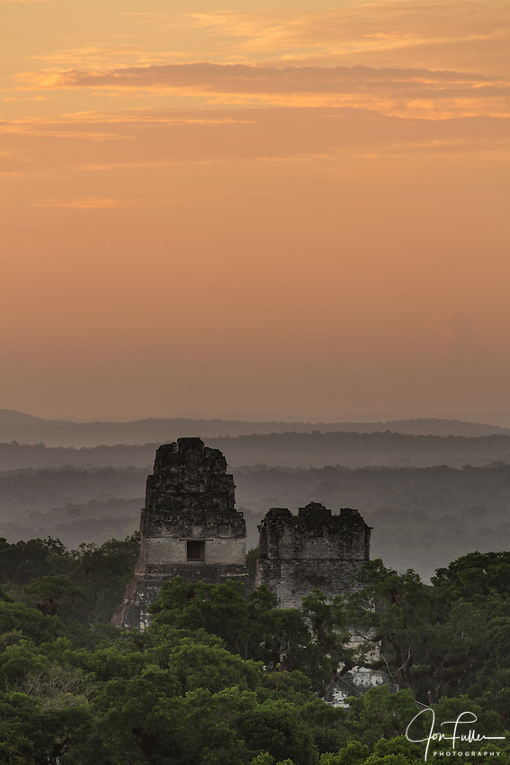 Predawn view of Temples I and II from Temple IV in the Mayan archeological site of Tikal National Park, Guatemala.  A UNESCO World Heritage site since 1979.