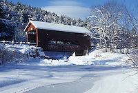 AJ4675, covered bridge, winter, Vermont, The Upper Covered Bridge crosses over the frozen waters of Cox Brook in the snow on a winter day in Northfield Falls in Washington County in the state of Vermont.