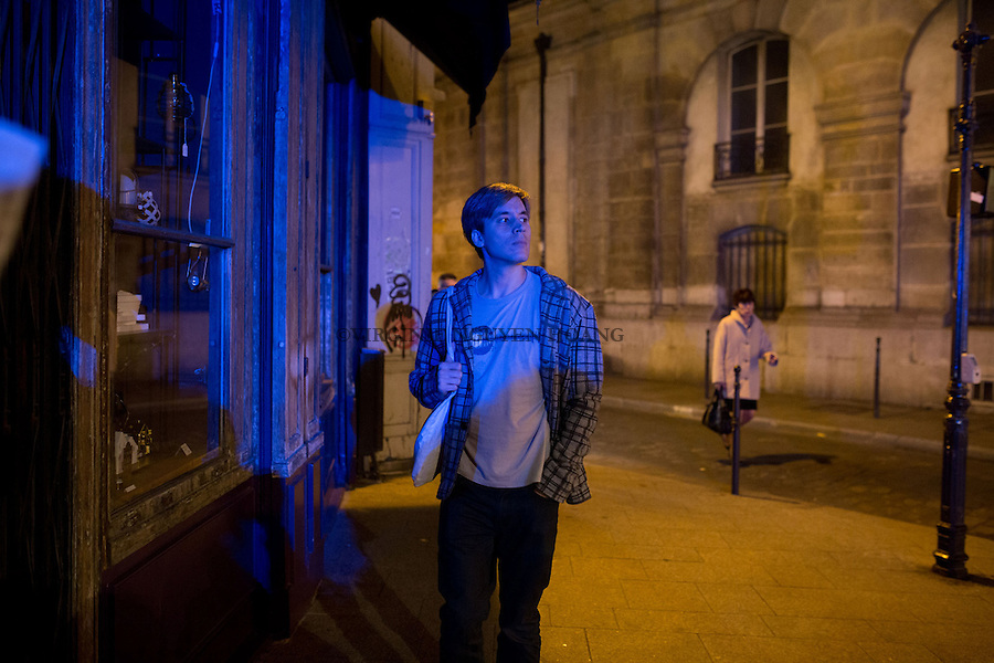PARIS, FRANCE - NOVEMBER 15: A man getting anxious as fire trucks were driving around Paris at around 7.30pm on November 15,2015. A hoax created an atmosphere of panic inside Paris with a  crowd movement Place de la Republique.