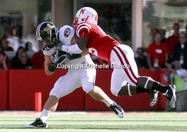 Nebraska cornerback Alfonzo Dennard (15) brings down Missouri wide receiver T.J. Moe (28) during the first half. No. 14 Nebraska beat  No. 7 Missouri 31-17 at Memorial Stadium in Lincoln, Nebraska.