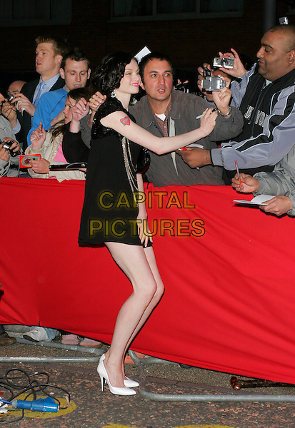 SOPHIE ELLIS BEXTOR.Arrivals - Greatest Britons 2007 Awards Show, .The London Studios, London, Engand, May 21st 2007. .full length black mini dress singing autograps fans posing for photo camera.CAP/AH.©Adam Houghton/Capital Pictures.