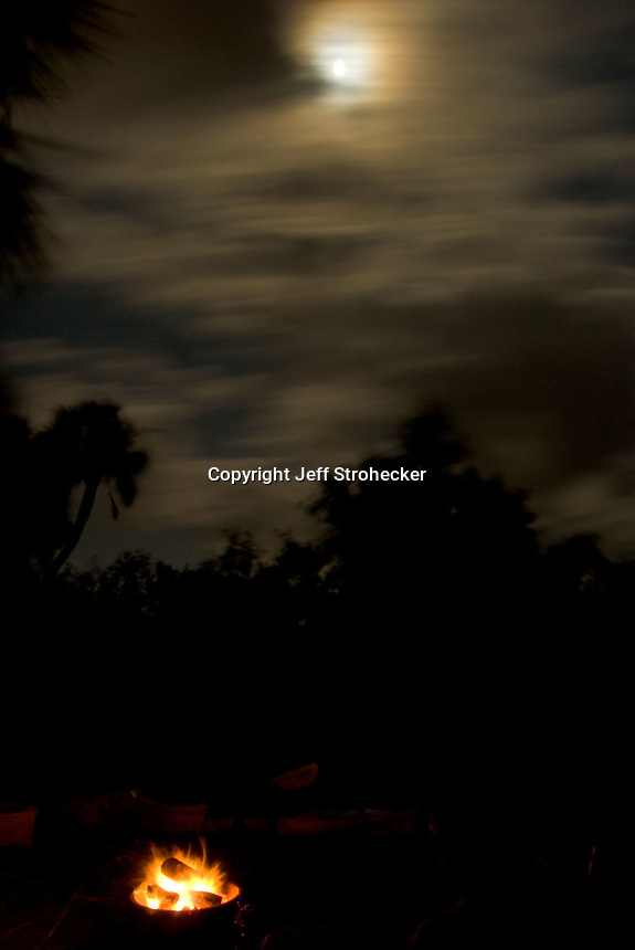 Moon during a windy cloudy night off of Ft. Desoto Park Campground at the mouth of Tampa Bay, Florida