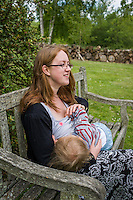 A mother  breastfeeding her child during a family outing to a local park and gardens.<br /> <br /> 11-06-2015