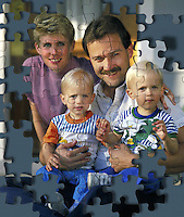 Portrait of a mother, father and small children as a puzzle.