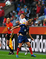 Christie Rampone (l) of team USA and Eugenie Le Sommer of team France during the FIFA Women's World Cup at the FIFA Stadium in Moenchengladbach, Germany on July 13th, 2011.