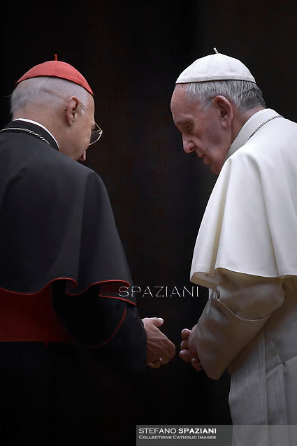 Pope Francis Cardinal Angelo Bagnasco, attends a vigil prayer on the eve of the XIV General Assembly of the Synod of Bishops at St Peter's basilica on October 3, 2015 at the Vatican.