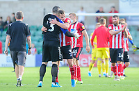 Fleetwood Town's Matt Gilks hugs Lincoln City's Harry Toffolo at the end of the game<br /> <br /> Photographer Chris Vaughan/CameraSport<br /> <br /> The EFL Sky Bet League One - Lincoln City v Fleetwood Town - Saturday 31st August 2019 - Sincil Bank - Lincoln<br /> <br /> World Copyright © 2019 CameraSport. All rights reserved. 43 Linden Ave. Countesthorpe. Leicester. England. LE8 5PG - Tel: +44 (0) 116 277 4147 - admin@camerasport.com - www.camerasport.com