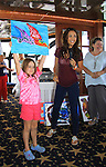 """General Hospital Lindsey Morgan """"Cristina Corinthos-Davis"""" auctions off her painting and Marlowe (Thorsten & Susan's daughter) at SoapFest's Celebrity Weekend - Cruisin' and Schmoozin' on the Marco Island Princess - mix and mingle and watching dolphins - autographs, photos, live auction raising money for kids on November 11, 2012 Marco Island, Florida. (Photo by Sue Coflin/Max Photos)"""
