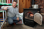 TERRYVILLE, CT05 January 2006-010506TK02  Chris Wald, owner of Back To Basics store in Terryville, beside his coal burning stove that warms his Terryville business.   Tom Kabelka / Republican-American (Chris Wald, coal)CQ